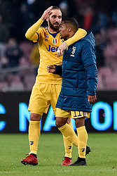 December 1, 2017 - Naples, Italy - Gonzalo Higuan of Juventus celebrates the victory with Douglas Costa of Juventus during the Serie A match between Napoli and Juventus at San Paolo Stadium, Naples, Italy on 1 December 2017. (Credit Image: © Giuseppe Maffia/NurPhoto via ZUMA Press)