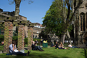 Scene as people sit in the sunshine during their lunch breaks in a small park just off Kensington Park Walk. In a selected few boroughs of West London, wealth has changed over the last couple of decades. Traditionally wealthy parts of town, have developed into new affluent playgrounds of the super rich. With influxes of foreign money in particular from the Middle-East. The UK capital is home to more multimillionaires than any other city in the world according to recent figures. Boasting a staggering 4,224 'ultra-high net worth' residents - people with a net worth of more than $30million, or £19.2million.. London, England, UK.