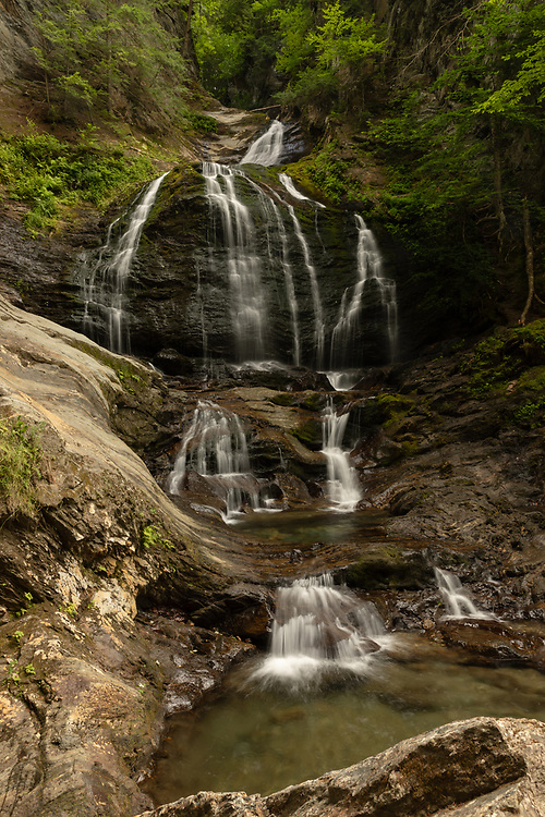 Vibrant summer greens at Moss Glen Falls in Stowe.