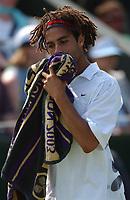 James Blake (USA) during his defeat to Sargis Sargisan (Armenia) Wimbledon Tennis Championship, Day 4, 26/06/2003. Credit: Colorsport / Matthew Impey DIGITAL FILE ONLY