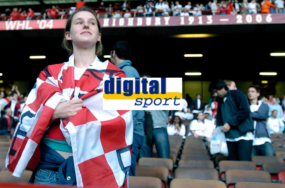Photo: Daniel Hambury.<br />Arsenal v Wigan Athletic. The Barclays Premiership. 07/05/2006.<br />A unidentified Arsenal fan with a flag draped around her shoulders.