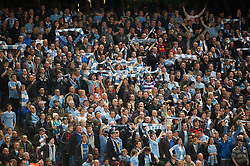 MANCHESTER, ENGLAND - Monday, April 30, 2012: Manchester City supporters in action against Manchester United during the Premiership match at the City of Manchester Stadium. (Pic by David Rawcliffe/Propaganda)