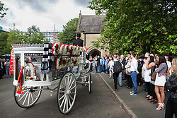 "© Licensed to London News Pictures . 28/08/2015 . Salford , UK . The procession arrives at the church  . The funeral of Paul Massey at St Paul's CE Church in Salford . Massey , known as Salford's "" Mr Big "" , was shot dead at his home in Salford last month . Photo credit : Joel Goodman/LNP"