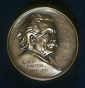 Albert Einstein (1879-1955), German-Swiss-American mathematical physicist, from the obverse of a commemorative medal.