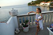 Female caucasian child (9 years old) on balcony, preparing for a swim, Racisce, island of Korcula, Croatia