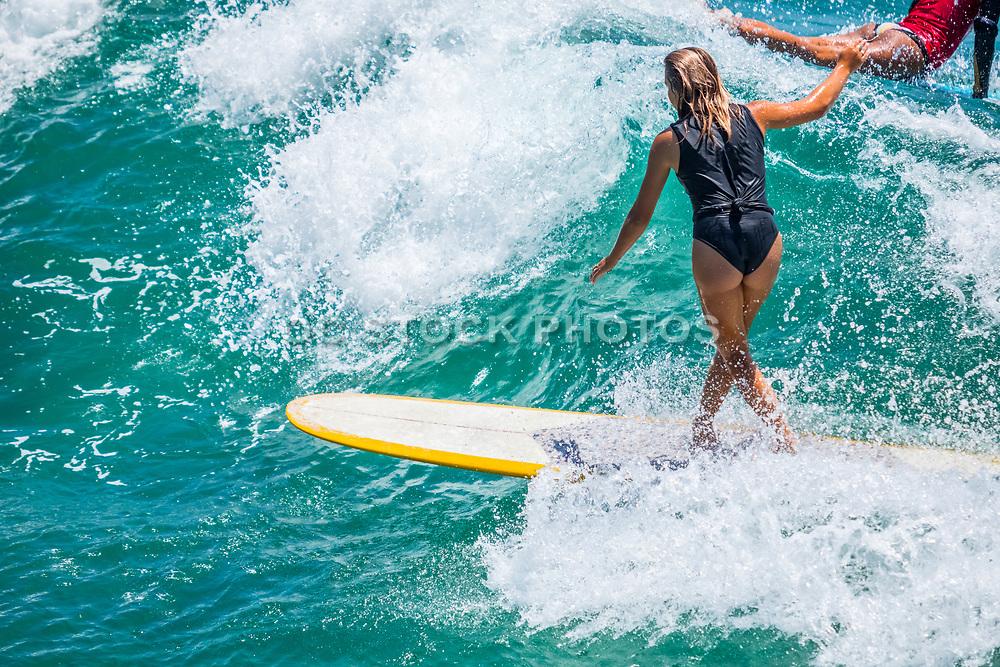 Female Surfing on a Long Board