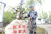UNSPECIFIC, CHINA - APRIL 17: (CHINA OUT) <br /> <br /> Monkey Helps Remove Birds In Air Force Airport<br /> <br /> <br /> A macaque helps the soldiers eliminate the barriers caused by birds on April 17, 2014 at an air force airport in China. The macaque was trained by experienced experts and can efficiently ruin the birds\' nestles, which is better than human labour to help ensure flight safety without much hurt to the birds. <br /> ©Exclusivepix