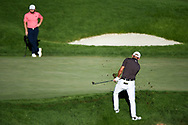 Tyrrell Hatton (ENG) watches Colin Morikawa (CAN) dig his ball out of the fringe on the 18th green during the final round at the CJ CUP, Shadow Creek, Las Vegas, Nevada, USA. 18/10/2020.<br /> Picture Ken Murray / Golffile.ie<br /> <br /> All photo usage must carry mandatory copyright credit (© Golffile | Ken Murray)