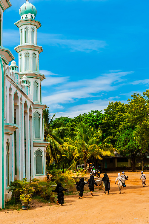 Muslim children going to Madrasa (religious school) at mosque near Trincomaleee, Sri Lanka.