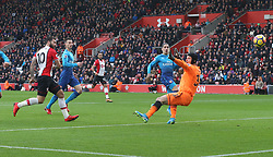 10 December 2017 Southampton : Premier League Football : Southampton v Arsenal : Charlie Austin (10) beats Arsenal goalkeeper Petr Cech  and scores the opening goal for Southampton.<br /> (photo by Mark Leech)