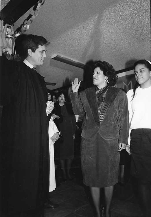 ©1991 Swearing in of District Clerk Amalia Rodriguez-Mendoza at the first Hispanic Clerk in Travis County.