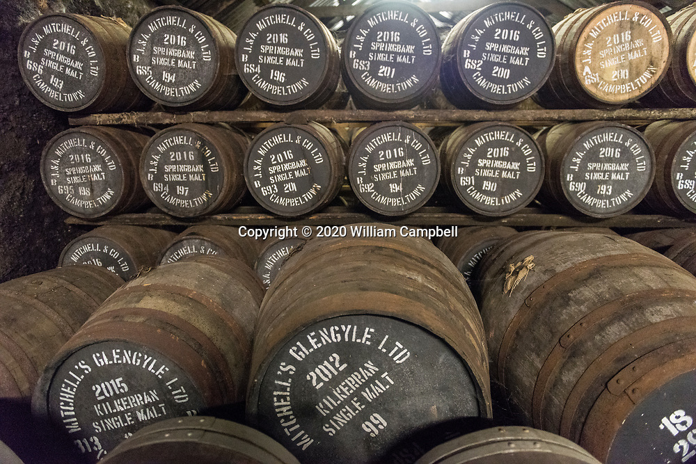 Whisky casks at Springbank Distillery. The whisky must mature at least three years to be Scotch whisky. The Springbank single malt whisky distillery in Campbeltown, Scotland is the only distillery in Scotland that produces 100% of the whisky making process in their own distillery.