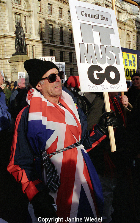 Pensioner's demonstration in Trafalgar Square central london in January 2004 complain about the government council tax.