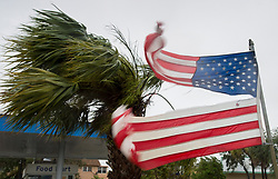 A torn American flag flutters in the wind as Hurricane Irma passes through Fort Lauderdale, FL, USA, on Sunday, September 10, 2017. Photo by Paul Chiasson/CP/ABACAPRESS.COM