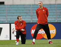 Photo: AF Wrofoto/Sportsbeat Images.<br />Manchester United training session. UEFA Champions League. 03/04/2007.<br />Wayne Rooney with Rio Ferdinand during training.