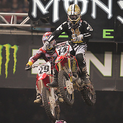 14 March 2009: Kevin Windham (14) stays ahead of Andrew Short (29) during the Monster Energy AMA Supercross race at the Louisiana Superdome in New Orleans, Louisiana