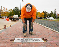 Setting the bricks for the Wow Trail Phase 2 walkway at the Laconia Railroad Station.  (Karen Bobotas Photographer)