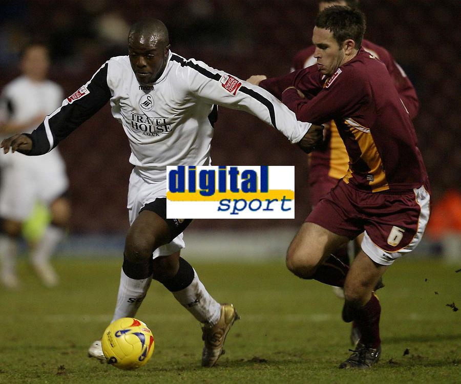 Photo: Aidan Ellis.<br /> Bradford City v Swansea City. Coca Cola League 1. 13/01/2007.<br /> Swansea's Adebayo Akinfenwa (L) takes on Braford's Mark Bower