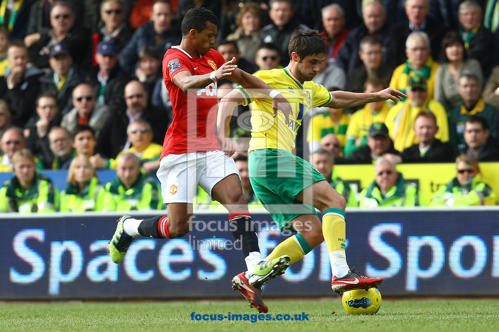 Picture by Paul Chesterton/Focus Images Ltd.  07904 640267.26/02/12.Nani of Man Utd and Andrew Surman of Norwich in action during the Barclays Premier League match at Carrow Road Stadium, Norwich.