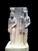 Limestone statue representing Isis and epwawet. 19th Dynasty, reign of Ramses II circa 1279-1213 BC. Isis was the patron goddess of the Royal scribe Siaset, who commissioned this statue. Wepwawet was the god of the Town of Assiut where it was made.