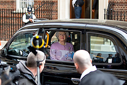 © Licensed to London News Pictures. 23/04/2018. London, UK. A figure of the queen is seen in a black taxi outside the Lindo Wing of St Mary's Hospital in west London, after The Duke and Duchess of Cambridge's new born baby son, the Prince of Cambridge was born at 11:01 AM today. The baby weighed 8lbs 7oz and is fifth in line to the throne. Photo credit : Tom Nicholson/LNP