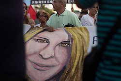 August 17, 2017 - Athens, Greece - Demonstrators participate in a march and rally'From Athens to Charlottesvile'  against white supremacy on August 17, 2017 in Athen, Greece. Protesters march to the Embassy of the United States of America, in memory of Heather Heyer. Heather died in the age of 32, when a 20 year old white supremacist/neonazi driver slammed into a crowd of counter protesters during a rally in Charlottesville, Pennsylvania  (Credit Image: © Maria Chourdari/NurPhoto via ZUMA Press)