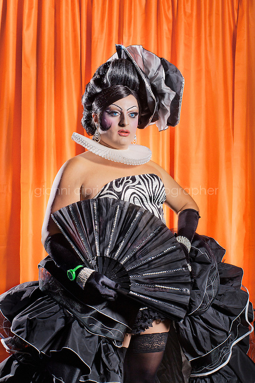 TORRE DEL LAGO, ITALY - JULY 31, 2011: Raven, 29, participates at the Miss Drag Queen Italy the contest, the only contest and festival for Drag Queens in Italy, in Torre del Lago. Torre del Lago is well known for being an important gay and gay-friendly summer resort of national and international appeal. It is considered the gay mecca of Italy. A drag queen is usually a man who dresses, and usually acts, like a caricature woman often for the purpose of entertaining. Generally, drag queens dress in a female gender role, often exaggerating certain characteristics (such as make-up and eyelashes) for comic, dramatic or satirical effect.
