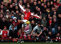 Photo: Javier Garcia/Back Page Images<br />Arsenal v Fulham, FA Barclays Premiership, Highbury, 26/12/04<br />Dennis Bergkamp and Moritz Volz take to the air