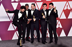 Bob Persichetti, Peter Ramsey, Rodney Rothman, Phil Lord, and Christopher Miller with their Oscars for best animated feature film for Spider-Man: Into The Spider-Verse in the press room at the 91st Academy Awards held at the Dolby Theatre in Hollywood, Los Angeles, USA.