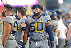Sep 11, 2021; Morgantown, West Virginia, USA; West Virginia Mountaineers offensive lineman Brandon Yates (50) walks along the sidelines during the third quarter against the Long Island Sharks at Mountaineer Field at Milan Puskar Stadium. Mandatory Credit: Ben Queen-USA TODAY Sports