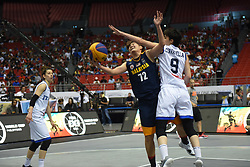 June 9, 2018 - Bulacan, Philippines - Chiau Teng Eugene Ting of Malaysia attempts to get past her defender during the match up between Italy and Malaysia for the FIBA 3x3 tournament held at the Philippine Arena in the province of Bulacan, north of Manila on 09 June 2018. (Credit Image: © George Calvelo/NurPhoto via ZUMA Press)