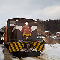 Enjoying a nice sightseeing trip on the famous stove train on the Tsugaru Railway. This diesel locomotive pulls this old fashioned train during the winter season only.