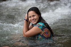 Cynthia Montes bathes in the Guapinol river. Members of her community have been criminalised and imprisoned for protesting against a massive mining operation that affects the river.