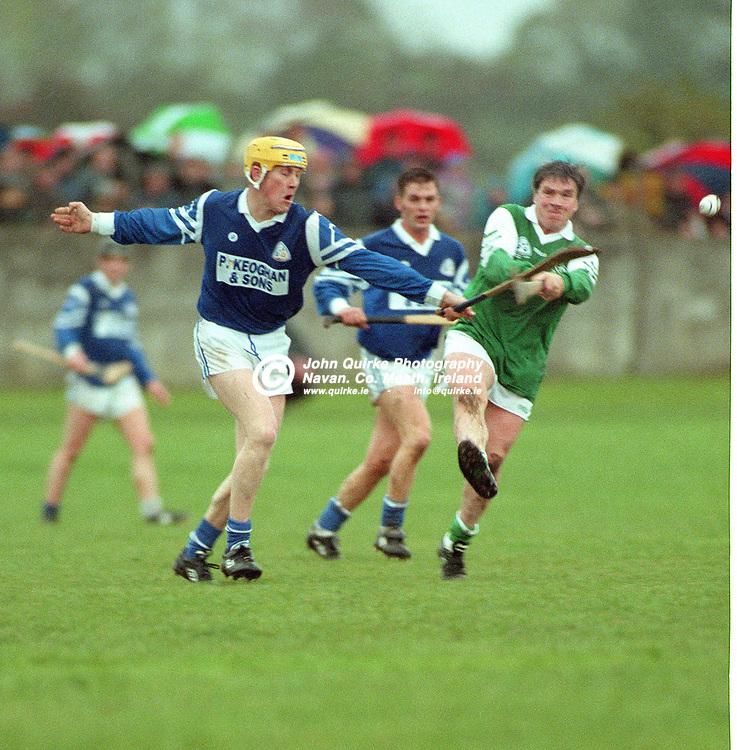 27-10-1996. Rathmolyon v Kilmessan - Meath SHC Final 1996.<br /> Anton O'Neill, Kilmessan blocking down Pat Farrell's, shot.<br /> Photo: John Quirke / www.quirke.ie<br /> ©John Quirke Photography, 16 Proudstown Road, Navan. Co. Meath. (info@quirke.ie / 046-9028461 / 087-2579454).