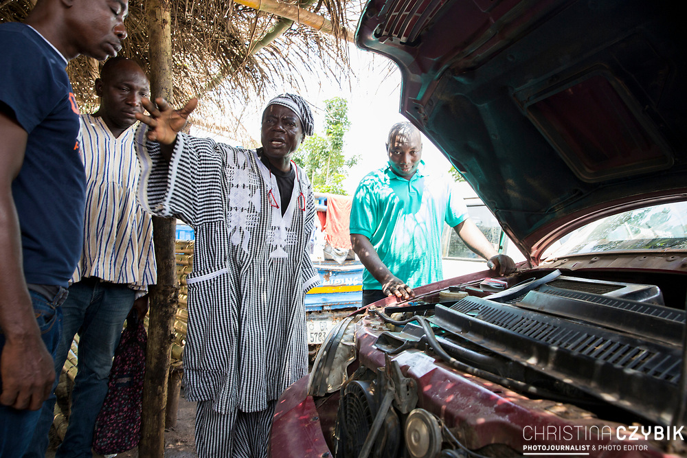King Cephas Bansah who also works as a mechanic visits a car shop near their soon to be opened new palace  in Hohoe, Ghana on September 5th, 2016.<br /> <br /> The King and Queen saving their own money and building this palace since 20 years.<br /> <br /> ***Togbe Ngoryifia Cephas Kosi Bansah of Gbi Traditional Area Hohoe Ghana and Traditional, Spiritual and Honorable King of the Ewes and his wife, Queen Mother Gabriele Akosua Bansah Ahado Hohoe Ghana***