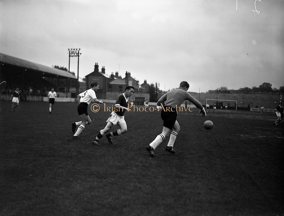 13/05/1960<br /> 05/13/1960<br /> 13 May 1960<br /> Soccer, Schoolboys International: Ireland v England at Tolka Park, Dublin. The game ended in a 2-2 draw. Picture shows Ireland's centre forward R. Cray attempting to intercept English goalie L. Ker's kick out.