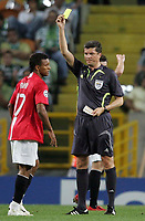 Photo: Paul Thomas.<br /> Sporting Lisbon v Manchester United. UEFA Champions League Group F. 19/09/2007.<br /> <br /> Nani (17) of Utd gets a yellow card from referee Herbert Fandel.