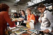 Milano, festival dello yoga al superstudio , gli stand all'interno del festival....Milan, yoga festival,book stall.
