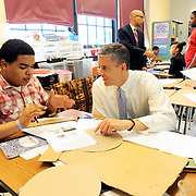U.S. Secretary of Education Arne Duncan works with Josian Estrella, tenth grader, in an Algebra class at P-TECH (Pathways in Technology Early College High School), a grades 9-14 school that combines high school and college with career and technical education, Tuesday, October 23, 2012 in Brooklyn, NY.  The school is a collaboration with the New York City Department of Education, the City University of New York and IBM and is designed to prepare students to fill entry-level jobs in technology fields. (Feature Photo Service)
