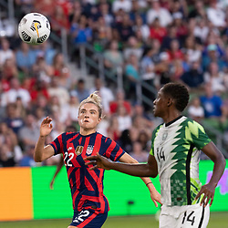 USA's KRISTIE MEWIS (22) challenges CHIDINMA OKEKE (14) of Nigeria as the US Women's National Team (USWNT) beats Nigeria, 2-0 in the inaugural match of Austin's new Q2 Stadium. The U.S. women's team, an Olympic favorite, is wrapping up a series of summer matches to prep for the Tokyo Games.