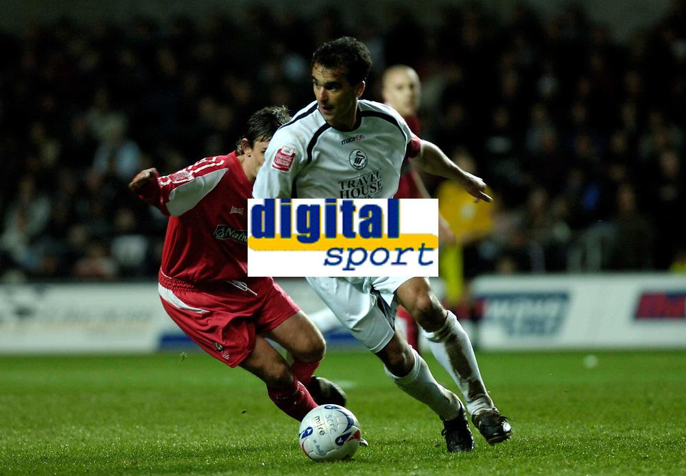 Photo: Adam Davies.<br /> Swansea City v Swindon Town. Coca Cola League 1. 11/04/2006.<br /> Swansea's Roberto Martinez out turns Swindon's Gareth Whalley.