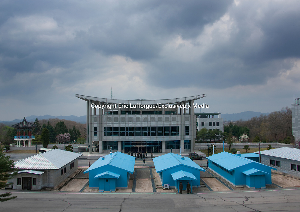THE BOTH SIDES OF THE DMZ<br /> <br /> I first visited the Demilitarized Zone on the North Korean side in 2008. The DMZ is a 250 km long, 4km wide stretch of land that serves as a buffer zone between North and South Korea.<br /> I came back 5 times there before being banned by the North Korean regim.<br /> I visited the DMZ on the South Korean side twice in 2016 and 2017.<br /> The both sides have huge differences but not in the way you may expect sometimes...<br /> The two Koreas have signed armistice but not peace. The Joint Security Area in Panmunjom is called a « demilitarized zone », but in fact it is the most armed zone in the world and also a major touristic attraction both in North and South with more than 100 000 tourists coming there every year.<br /> <br /> Photo shows:  In Panmunjom, the soldiers from the two countries must remain totally static when they face the other side in the Joint Security Area (JSA).<br /> This attitude may seem very painful but in fact, they are here only when some visitors are coming! When there are no visitors, they go back to their main building, and the place is empty.<br /> ©Eric Lafforgue/Exclusivepix Media
