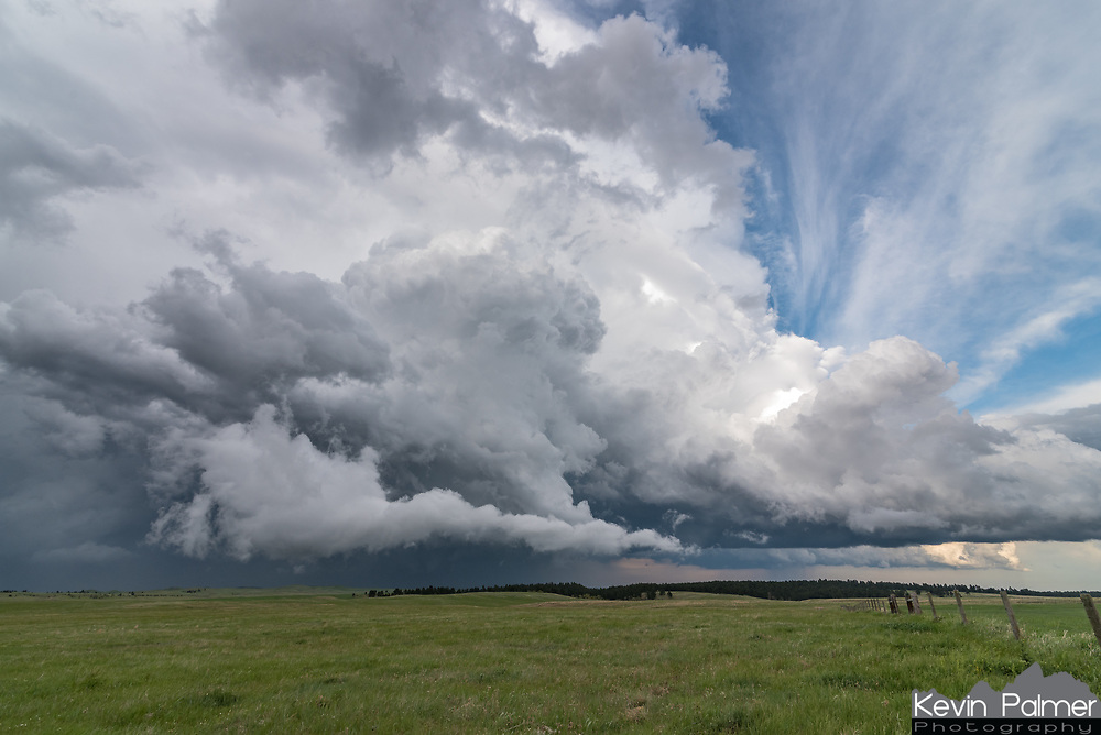 This severe, slow-moving thunderstorm in northeast Wyoming was fascinating to watch. It was showing broad rotation, and was a prolific hail producer. I had to wait for the hail to move away from Highway 112 before I drove any further. Once I went north I found hail stones 2 inches wide which would have damaged my vehicle.