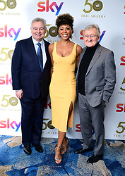 Eamonn Holmes (left), Dr Zoe Williams and Dr Chris Steele attending the TRIC Awards 2019 50th Birthday Celebration held at the Grosvenor House Hotel, London.