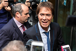 © Licensed to London News Pictures. 18/07/2018. London, UK. SIR CLIFF RICHARD (R) arrives at the Rolls Building of the High Court in London where judges will deliver their decision on his claim for damages against the BBC for loss of earnings. The 77-year-old singer is suing the corporation after his home in Sunningdale, Berkshire was raided following allegations of sexual assault made to Metropolitan Police. Photo credit: Rob Pinney/LNP