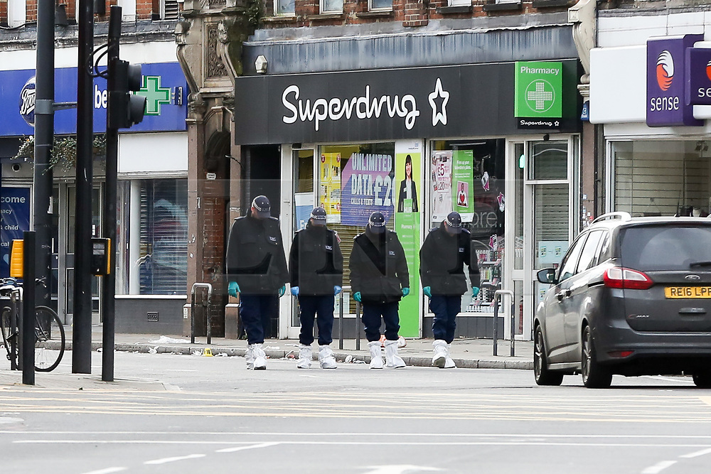 © Licensed to London News Pictures. 03/02/2020. London, UK. Search team officers carry out the search on Streatham High Road where 20 year old, Sudesh Amman was shot by police after he stabbed people on Sunday 2 February. Sudesh Amman was released last week after serving half of his sentence of three years and four months for terror offences and was under police surveillance at the time of the attack on Streatham High Road. Metropolitan Police declared the incident as a terrorist-related. Photo credit: Dinendra Haria/LNP