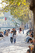 The banks of the Canal St Martin becomes a popular place for people to meet in the summer months in Paris, France