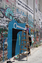 Graffiti artists working on the wall of separation in Bethlehem. From a series of travel photos taken in Jerusalem and nearby areas. Photo date: Wednesday, August 1, 2018. Photo credit should read: Richard Gray/EMPICS