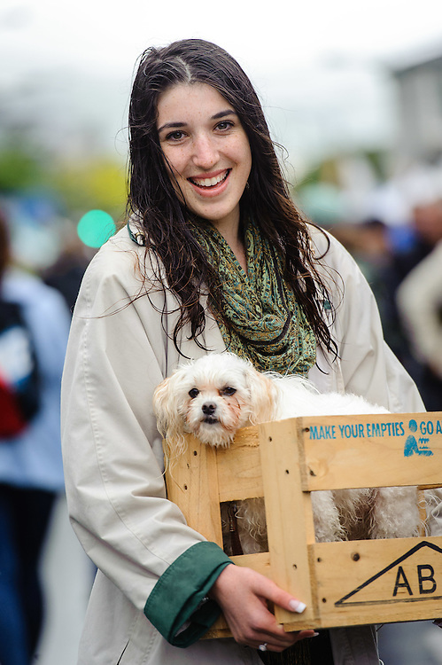 WELLINGTON, NEW ZEALAND - December 07:  Ebony Visser carries her dog in a beer crate through Thorndon Fair. The crate is for her sister to sit on while she works at a stall in the fair. Ebony decided to carry her dog in the crate as it was tired from walking through the fair all day. December 07, 2014 in Wellington, New Zealand.  REAL PEOPLE.  (Photo by Mark Tantrum/ real-people.co.nz)