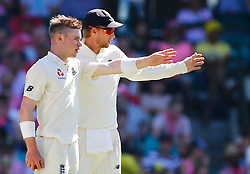 England's Mason Crane talks with Joe Root during day two of the Ashes Test match at Sydney Cricket Ground.